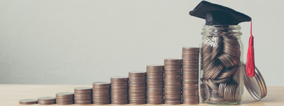 Student finance image - Moneybox and graduation hat