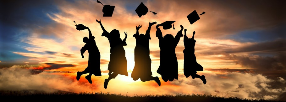 An image of students with graduation hats jumping into the sunset
