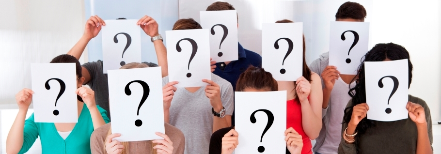Image of students holding question mark boards